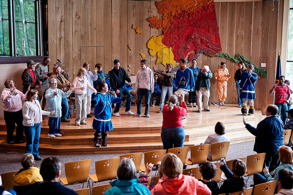Native Alaskan youth demonstrates the traditional dance of her culture at the Native Alaskan Heritage Center, Anchorage, Alaska, USA