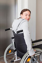 Young woman using wheelchair