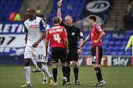 Oldham Athletic's James Wesolowski receives a yellow card. Skybet football league 1match, Tranmere Rovers v Oldham Athletic at Prenton Park in Birkenhead, England on Saturday 1st March 2014.<br /> pic by Chris Stading, Andrew Orchard sports photography.