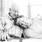 Ivan Mahoney visits his wife, Dot, at the memory-care facility in Salem, Ore., where she now lives. The couple has been married for 63 years.