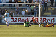 Harry Worley of Newport sees his header fly past his own goalkeeper  to give Exeter the lead. Skybet football league two match, Newport county v Exeter city at Rodney Parade in Newport, South Wales on Sunday 16th March 2014.<br /> pic by Mark Hawkins, Andrew Orchard sports photography.