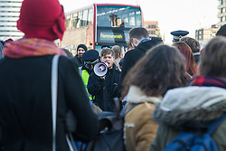 "Westminster, London, January 19th 2016. Students hold an ""emergency protest"" in Parliament Square and later blocking Westminster Bridge, against the cutting of maintenance grants. ""It took just 18 MPs 90 minutes to scrap maintenance grants for the million poorest students, without a debate in Parliament in a backroom committee"" PICTURED: A protester uses a loudhailer to lead chants of ""No grants, no bridge!"". ///FOR LICENCING CONTACT: paul@pauldaveycreative.co.uk TEL:+44 (0) 7966 016 296 or +44 (0) 20 8969 6875. ©2015 Paul R Davey. All rights reserved."