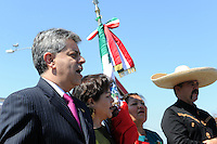"""Carlos Ponce Martinez, left, consul general of Mexico to San Jose, sings Mexico's national anthem with other officials at Sunday's """"El Grito"""" ceremony in Salinas marking September 16th's anniversary of Mexico's independence from Spain. The annual fiesta, which occupies East Alisal Street between Wood and Sanborn, brimmed as usual with booths selling patriotic souvenirs and all manner of food and drink. Local businesses and nonprofits manned booths with information about health and community programs, while traditional """"bandas"""" filled the afternoon with dance music and good cheer."""