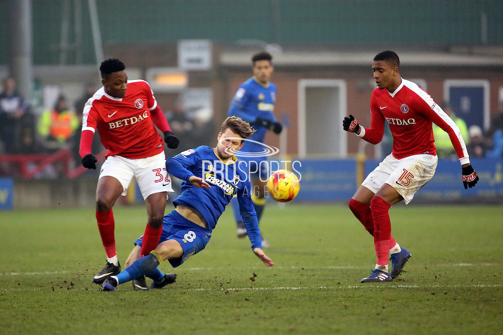 AFC Wimbledon midfielder Jake Reeves (8) tackling Charlton Athletic midfielder Joe Aribo (32) during the EFL Sky Bet League 1 match between AFC Wimbledon and Charlton Athletic at the Cherry Red Records Stadium, Kingston, England on 11 February 2017. Photo by Matthew Redman.
