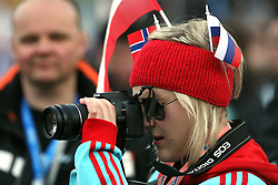 Fan of Slovenia and Norway with a camera at e.on Ruhrgas FIS World Cup Ski Jumping on K215 ski flying hill, on March 14, 2008 in Planica, Slovenia . (Photo by Vid Ponikvar / Sportal Images)./ Sportida)