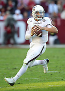 TUSCALOOSA, AL - NOVEMBER 10:  Quarterback Johnny Manziel #2 of the Texas A&M Aggies runs and looks downfield during the game against the Alabama Crimson Tide at Bryant-Denny Stadium on November 10, 2012 in Tuscaloosa, Alabama.  (Photo by Mike Zarrilli/Getty Images)