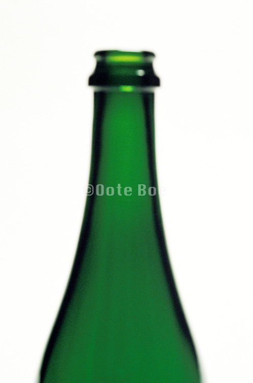 blurry close up of wine bottle neck
