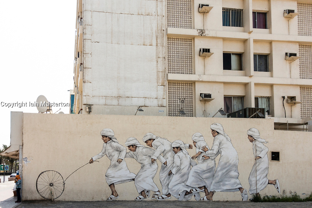 Street art on buildings along 2 December Street in Satwa District of Dubai, United Arab Emirates, UAE