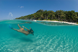 Snorkeler Zan VanBrunschot explores the sunlit shallows off Radhanagar Beach, a.k.a. Beach #7, Havelock Island, Andaman Islands, Andaman Sea, India