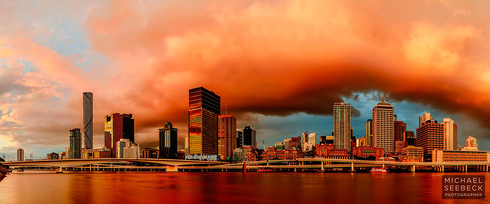 Heavy cumulus clouds pass over Brisbane late in the afternoon just before sunset.<br /> <br /> Code: CAQS0001<br /> <br /> Limited Edition Print