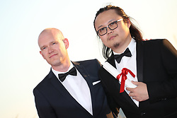 Teppo Airaksinen (L) winner of special mention for his short film The Ceiling (Katto) and Qiu Yang winner of the award for Best Short for A Gentle Night (Xiao Cheng Er Yue) attend the Palme DOr winner photocall during the 70th annual Cannes Film Festival at Palais des Festivals on May 28, 2017 in Cannes, France. Photo by Shootpix/ABACAPRESS.COM