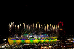 © Licensed to London News Pictures. 12/08/2012. LONDON, UK. Fireworks are seen over the Olympic Stadium as it is lit in the Brazilian national colours during the closing ceremony of the 2012 Summer Olympics in London today (12/08/12). The Games of the 30th Olympiad today come to a close in London after two weeks of athletics and sports competition carried out by 204 countries from around the world. Photo credit: Matt Cetti-Roberts/LNP