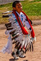 A 4 year old boy from the Oak Canyon Dance Group (Jemez Pueblo) performs the Eagle Dance,  Indian Pueblo Culture Center, Albuquerque, New Mexico USA