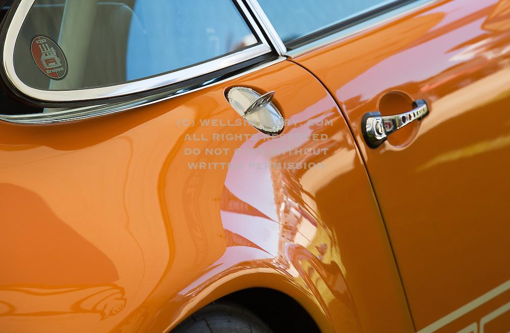 Car detail of an orange Porsche 911 T/ST at Rennsport Reunion V at Laguna Seca in Monterey, California, America west coast