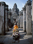 The Temple of Bayonne near Ankor was built by the ruler Jayavarman VII between 1181 and 1200 A.D.  It features stone carvings of Buddha faces on the towers of the third level and a stone Buddha sculpture here on the first.