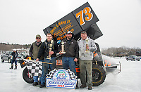 Steve Durand preseented the winning trophies to the top three finishers in the Sprint class during Sunday's Latchkey Cup on Meredith Bay.  (l-r) Steve Durand with 1st place finisher #73  Jake Williams, 2nd place #01 DJ Mills and 3rd place #11 Tunk Berry.  (Karen Bobotas/for the Laconia Daily Sun)