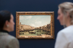 """© Licensed to London News Pictures. 01/12/2017. London, UK.  Staff members view """"The Grand Canal, looking north from near the Rialto Bridge"""", 1738, by Bernardo Bellotto, (Est.  GBP2.0-3.0m).  Preview of """"Masters of Light"""", Sotheby's Old Masters Evening Sale which will take place on 6 December at Sotheby's, New Bond Street. Photo credit: Stephen Chung/LNP"""