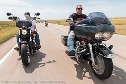 Ryan Hibbard (left) and Brian Hibbard (right) of West Barnstable, MA ride back to Sturgis after the annual Michael Lichter - Sugar Bear Ride hosted by Jay Allen with the Easyriders Saloon during the Sturgis Black Hills Motorcycle Rally. SD, USA. Sunday, August 3, 2014. Photography ©2014 Michael Lichter.
