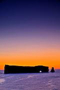 Rocher percé (Percé Rock)  at dawn and the Atlantic Ocean<br /> Percé <br /> Quebec<br /> Canada