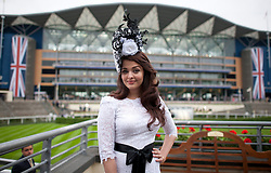 © London News Pictures. 18/06/2013. Ascot, UK.  Bollywood actress Aishwaraya Rai Bachcan poses for the media in an elaborate hat on day one of Royal Ascot at Ascot racecourse in Berkshire, on June 18, 2013.  The 5 day showcase event,  which is one of the highlights of the racing calendar, has been held at the famous Berkshire course since 1711 and tradition is a hallmark of the meeting. Top hats and tails remain compulsory in parts of the course. Photo credit should read: Ben Cawthra/LNP