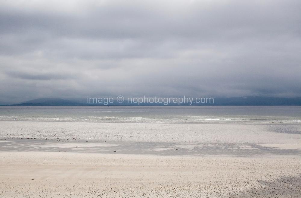 Low tide on a quiet beach near Bearna Galway in Ireland