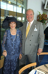 RORY MORE O'FERRALL the director of external affairs at De Beers and his mother MRS GEORGE MORE O'FERRAL at the King George VI and The Queen Elizabeth Diamond Stakes sponsored by De Beers for the 35th year held at Ascot Racecourse, Berkshire on July 29th 2006.    De Beers hosted a lunch before the races for about 250 people.<br /><br />NON EXCLUSIVE - WORLD RIGHTS