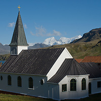 A church, built in 1913, contrasts with the industrial-scale killing undertaken at Grytviken, a British whaling station by  Cumberland Bay, South Georgia, Antarctica.