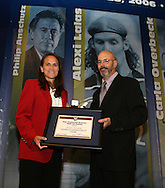 28 August 2006: Carla Overbeck (l) receives her Hall of Fame jacket, plaque, and ring, from HOF president Will Lunn (r). The National Soccer Hall of Fame Induction Ceremony was held at the National Soccer Hall of Fame in Oneonta, New York.