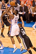 June 2, 2012; Oklahoma City, OK, USA; Oklahoma City Thunder guard James Harden (13) takes a shot under pressure from San Antonio Spurs guard Daequan Cook (14) during a playoff game  at Chesapeake Energy Arena.  Thunder defeated the Spurs 109-103 Mandatory Credit: Beth Hall-US PRESSWIRE