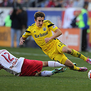 Ethan Finlay, (right), Columbus Crew, is fouled by Eric Alexander, New York Red Bulls, during the New York Red Bulls Vs Columbus Crew, Major League Soccer regular season match at Red Bull Arena, Harrison, New Jersey. USA. 19th October 2014. Photo Tim Clayton