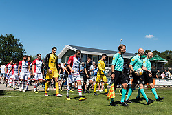 the teams of Heracles and FC Emmen enter the pitch during the Friendly match between Heracles Almelo and FC Emmen at Sportcomplex 't Brook on July 14, 2018 in Bornerbroek, The Netherlands