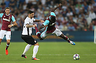 Cristian Sapunaru of Astra Giurgiu tackles Michail Antonio of West Ham United. UEFA Europa league, 1st play off round match, 2nd leg, West Ham Utd v Astra Giurgiu at the London Stadium, Queen Elizabeth Olympic Park in London on Thursday 25th August 2016.<br /> pic by John Patrick Fletcher, Andrew Orchard sports photography.