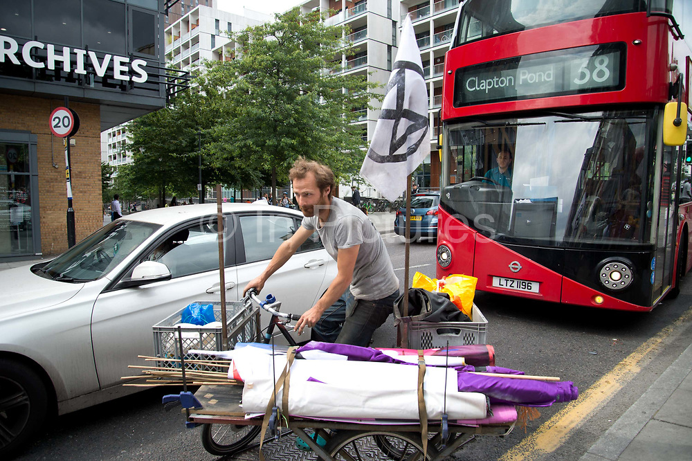 Extinction Rebellion - East London Uprising on July 13th 2019 in Hackney, London, United Kingdom. The air that we grieve swarm at Dalston Junction.