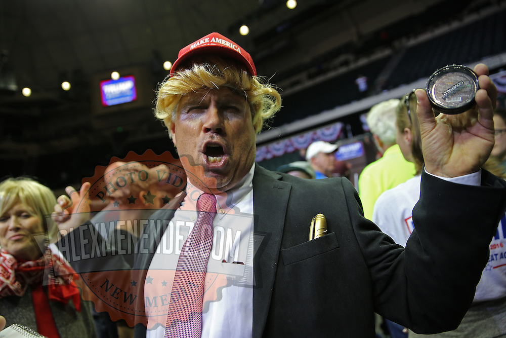 Supporter Todd Wertalick dresses up as Donald Trump during a rally for the US presidential campaign in Tampa, Florida, America - 12  Feb 2016