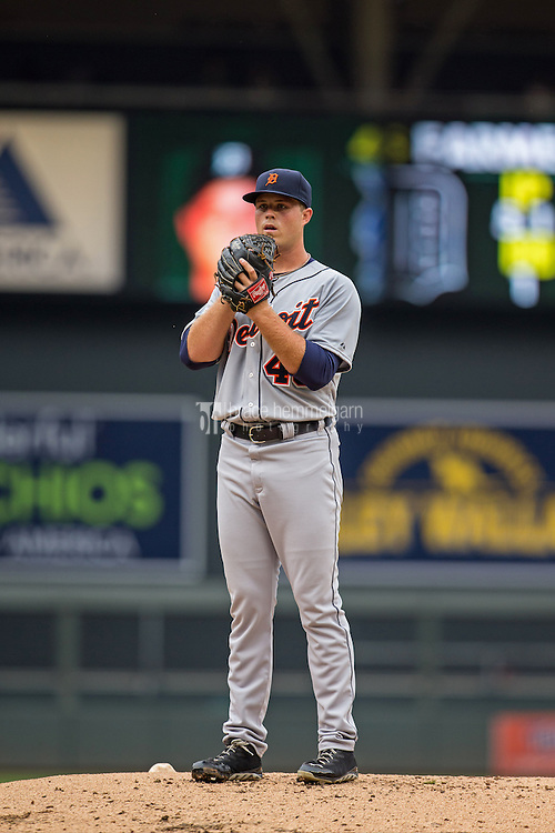 MINNEAPOLIS, MN- AUGUST 23: Buck Farmer #45 of the Detroit Tigers pitches against the Minnesota Twins on August 23, 2014 at Target Field in Minneapolis, Minnesota. The Twins defeated the Tigers 12-4. (Photo by Brace Hemmelgarn) *** Local Caption *** Buck Farmer