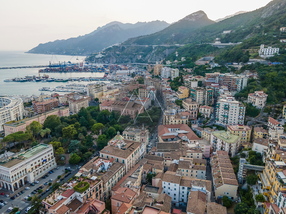 Aerial view of Salerno coastline at sunset, view of the city port and the Amalfi coastline, Salerno, Italy.