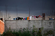 Laundry hangs on a newly build house on the edge of Lake Texcoco.