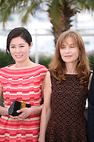 Moon Sori,  Isabelle Huppert, at the DA-REUN NA-RA-E-SUH (IN ANOTHER COUNTRY) film photocall at the 65th Cannes Film Festival. Monday 21st May 2012 in Cannes Film Festival, France.