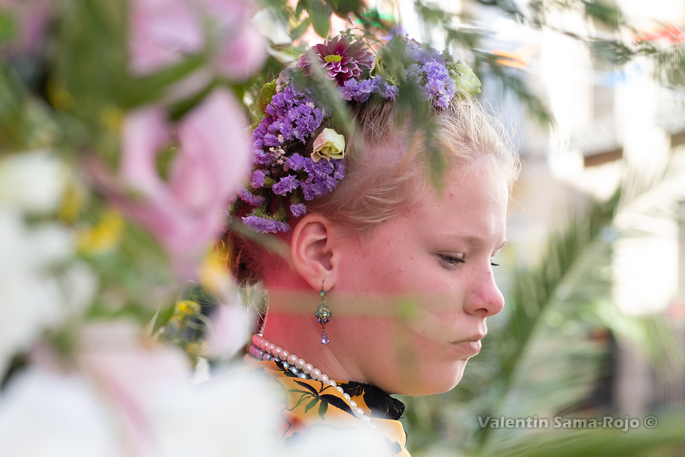 Madrid, Spain. 6th May, 2018. Profile portrait of the 'Maya' Marina wearing a tiara made of flowers a Manilla shawl and a pearls necklace sitting on her altar surrounded by flowers and plants. © Valentin Sama-Rojo.