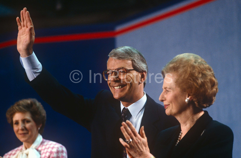 British Prime Minister, John Major is joined on stage by his wife Norma left and political predecessor, Margaret Thatcher during a Conservative party election rally on 23rd March 1992, in Brighton, England. Major went on to win the election weeks later and was the fourth consecutive victory for the Conservative Party although it was its last outright win until 2015 after Labours 1997 win for Tony Blair.