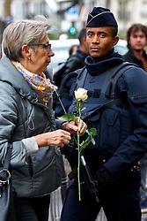 © Licensed to London News Pictures. 16/11/2015. Paris, France. French armed police patrolling a memorial outside Café Bonne Biére in Paris, France following the Paris terror attacks on Monday, 16 November 2015. Photo credit: Tolga Akmen/LNP