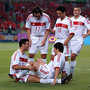 Turkey's Hakan Sukur celebrates scoring Turkey's first goal in the first minute of the game against Korea