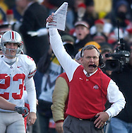 MORNING JOURNAL/DAVID RICHARD.Ohio State head coach Jim Tressel winds his arm while telling officials  to start the game clock late in the fourth quarter yesterday.