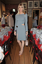 LADY EMILY COMPTON at a lunch hosted by Roger Viver in honour of Bruno Frisoni their creative director, held at Harry's Bar, 26 South Audley Street, London on 31st March 2011.