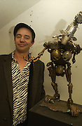 Joe Rush with one of his sculptures. Opening of  Santa's Ghetto. Mixed art exhibition.  9 Berwick St. Soho, London. 30  November 2005. ONE TIME USE ONLY - DO NOT ARCHIVE  © Copyright Photograph by Dafydd Jones 66 Stockwell Park Rd. London SW9 0DA Tel 020 7733 0108 www.dafjones.com