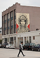 """Street art in Los Angeles..L.A. has become the new ground zero for avant-guard and cutting edge street and graffiti. Artist from around the world now come to L.A. to post their work..A mural by Shepard Fairey on a wall in the art's district of downtown L.A..Fairey is best know for his Obama """"Hope"""" poster."""