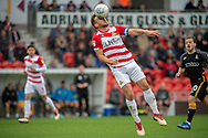 Doncaster Rovers defender Andrew Butler heads the ball during the EFL Sky Bet League 1 match between Doncaster Rovers and Bradford City at the Keepmoat Stadium, Doncaster, England on 22 September 2018.