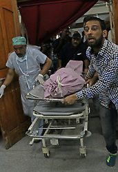 September 7, 2017 - India - People carry the wrapped body of civilian Masood Ahmad Shah to an ambulance at a local hospital. One civilian was killed and 13 others including a traffic policeman were injured when suspected militants lobbed a grenade towards paramilitary CRPF vehicle at Jehangir Chowk in Srinagar. (Credit Image: © Umer Asif/Pacific Press via ZUMA Wire)
