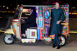 The Duke of Cambridge arrives by tuk tuk for a reception hosted by the British High Commissioner to Pakistan Thomas Drew CMG at the National Monument in Islamabad during the second day of the royal visit to Pakistan.