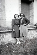 two woman pasing for photo 1950s 1960s